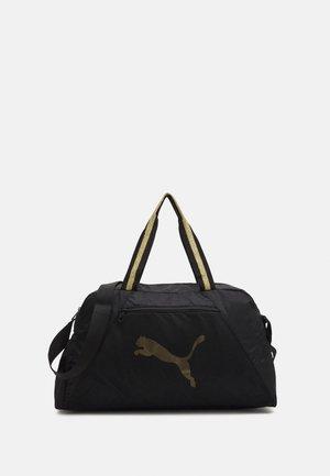 GRIP BAG 25 L - Sports bag - black/bright gold