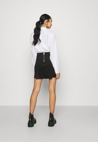 ONLY - ONLSARAH NEOLINE SKIRT  - Mini skirt - black