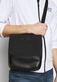 Emporio Armani - MESSENGER BAG UNISEX - Across body bag - black - 1