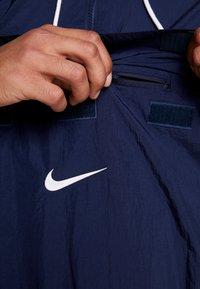 Nike Sportswear - Windbreaker - obsidian/white/university red - 5