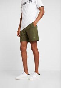 Calvin Klein Performance - SHORT - Sports shorts - green - 0