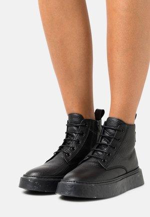 Ankle boots - elefante/nero
