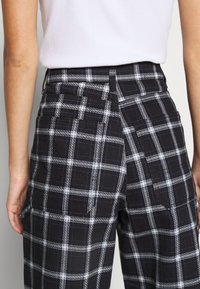 Topshop - CHECK CARPENTER - Trousers - navy - 5