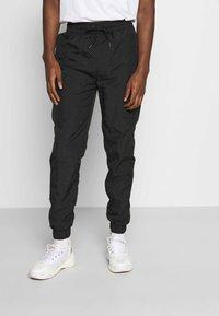 Criminal Damage - UTILITY JOGGER - Cargo trousers - black - 0