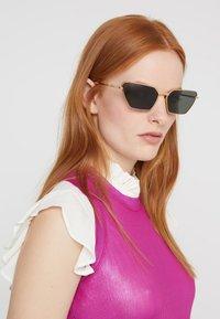 Gucci - Sunglasses - gold-coloured/grey - 1