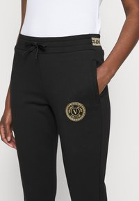 Versace Jeans Couture - Tracksuit bottoms - black/gold - 5