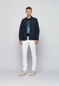 BOSS - DELAWARE - Slim fit jeans - white - 1