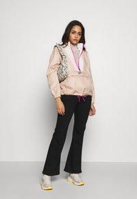 Nike Sportswear - Windbreaker - shimmer/pale ivory/fire pink - 1
