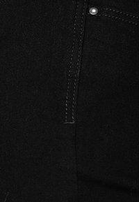 edc by Esprit - HIGH SKIN PANTS DENIM - Slim fit jeans - black denim - 4