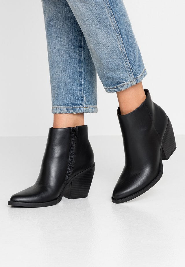 KLICCK - High heeled ankle boots - black
