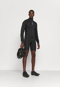 Gore Wear - INFINIUM™ THERMO JACKET - Soft shell jacket - black - 1