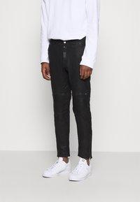 Tigha - ADEEL - Kalhoty - black - 0