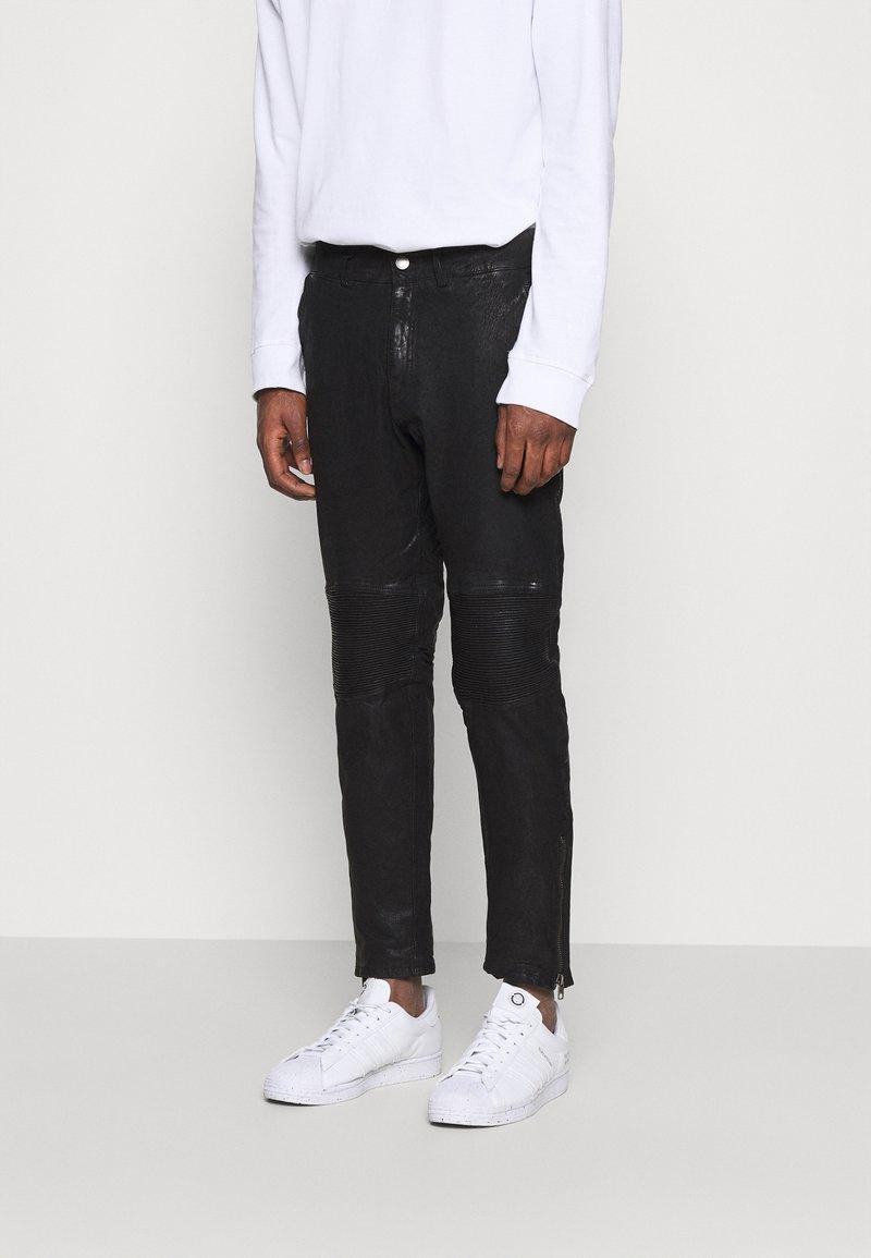 Tigha - ADEEL - Kalhoty - black