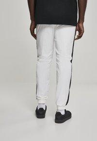 Urban Classics - Tracksuit bottoms - white, black - 2