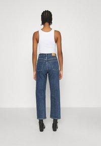 Monki - ZAMI LA LUNE - Straight leg jeans - blue medium dusty - 2