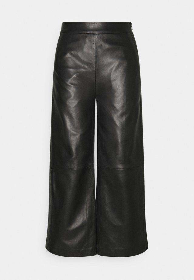 JOY TROUSERS - Leather trousers - black