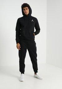 Jordan - JUMPMAN  - Pantalones deportivos - black - 1