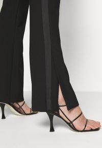 Victoria Victoria Beckham - SPLIT HEM TUXEDO TROUSER - Spodnie materiałowe - black - 8