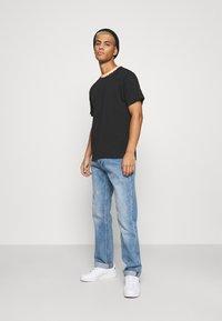 adidas Originals - DETAIL UNISEX - Camiseta básica - black - 1