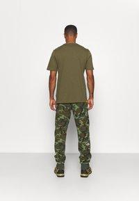 The North Face - MEDIUM - Pantaloni sportivi - olive - 2
