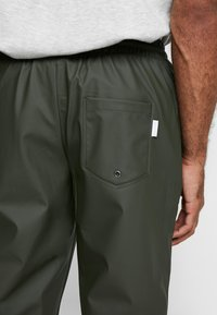 Rains - UNISEX TROUSERS - Trainingsbroek - green - 5