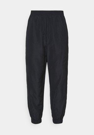 NMKAJA PANTS - Tracksuit bottoms - black