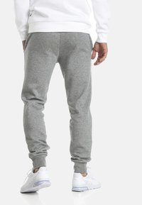 Puma - Tracksuit bottoms - medium gray heather - 2