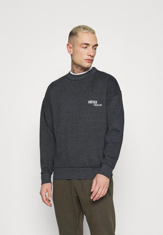 TOM  - Sweatshirt - black