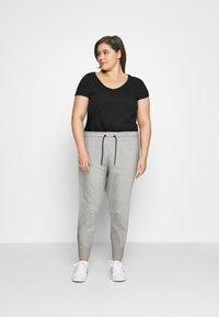 Nike Sportswear - Tracksuit bottoms - grey heather - 1