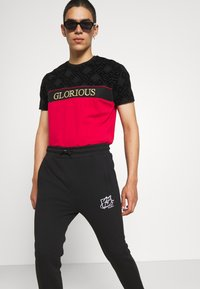 FUBU - SCRIPT - Pantaloni sportivi - black - 3