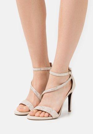 Højhælede sandaletter / Højhælede sandaler - light gold