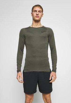 T-shirt sportiva - cargo khaki/black