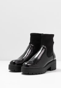 ONLY SHOES - ONLBRANKA TUPE BOOT - Platform ankle boots - black - 4