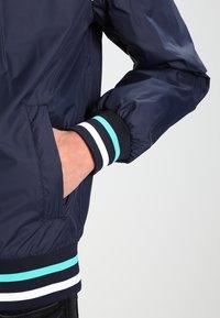Urban Classics - HOODED COLLEGE WINDBREAKER - Summer jacket - navy/mint/white - 4