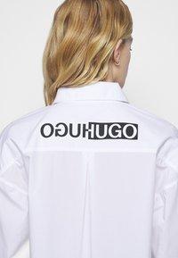 HUGO - EILISH - Button-down blouse - white - 4