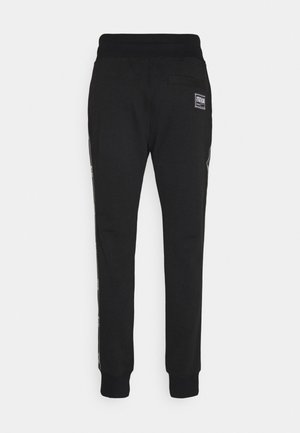 LIGHT - Tracksuit bottoms - black