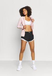 New Balance - SPEED FUEL SHORT - Sports shorts - black - 1