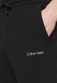 Calvin Klein - SMALL LOGO - Verryttelyhousut - black - 4