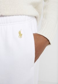 Polo Ralph Lauren - SEASONAL  - Tracksuit bottoms - white - 5