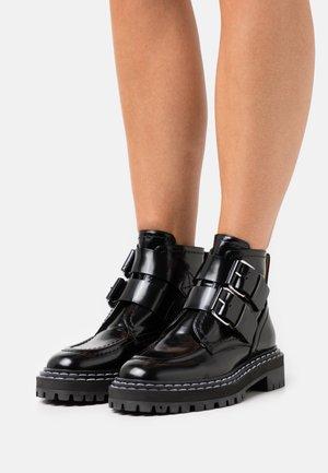 LUG SOLE BUCKLE BOOTS - Platform ankle boots - black