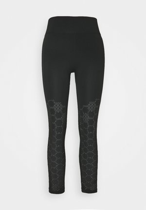 UNIVERSAL SEAMLESS  - Leggings - black