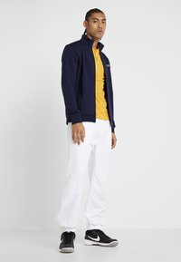 Lacoste Sport - TENNIS PANT - Tracksuit bottoms - white - 1