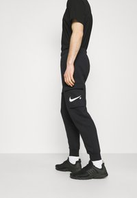 Nike Sportswear - COURT PANT - Tracksuit bottoms - black - 3