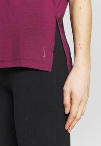 Nike Performance - YOGA LAYER - T-shirt basic - villain red/shadowberry - 5