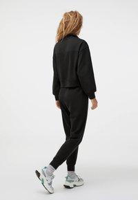 OYSHO - Trousers - black - 2