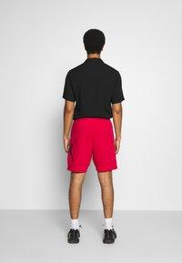 Jordan - JUMPMAN AIR  - Tracksuit bottoms - gym red/black - 2