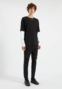 PULL&BEAR - Jeans Tapered Fit - mottled black - 1