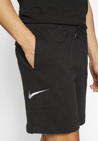 Nike Sportswear - Træningsbukser - black/white - 3