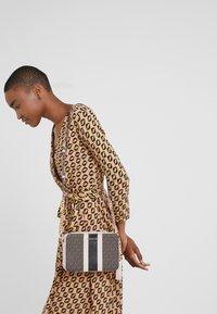MICHAEL Michael Kors - JET SET CAMERA BAG  - Across body bag - brown - 1