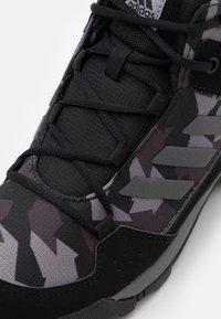adidas Performance - TERREX HYPERHIKER UNISEX - Hiking shoes - core black/night grey - 5